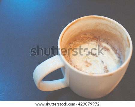 A cup coffee with blue background