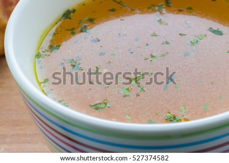 A cup of chicken broth