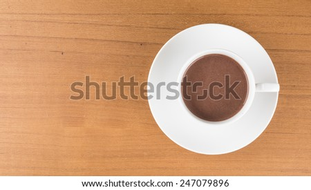 a cup of chocolate on wood table