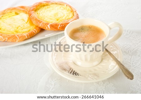 A cup of coffee and pudding pasties
