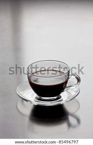 a cup of coffee on a table - stock photo