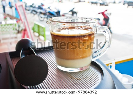 A cup of coffee on coffee machine,outdoor background