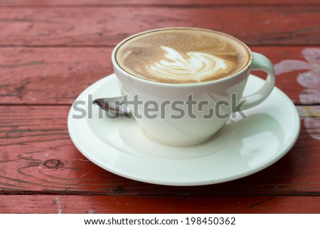 A cup of coffee on wooden