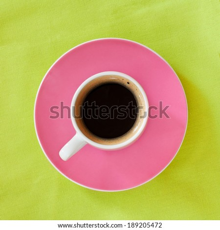 A cup of coffee over the green background - stock photo