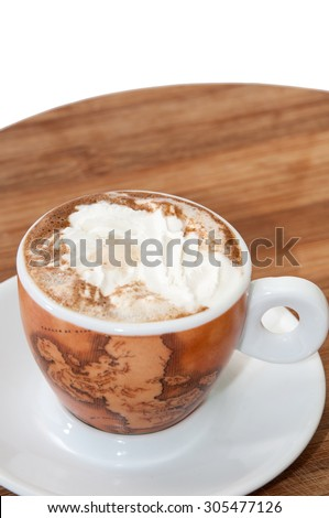 A cup of coffee with cream.