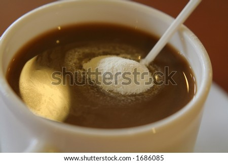 A cup of coffee with cream powder