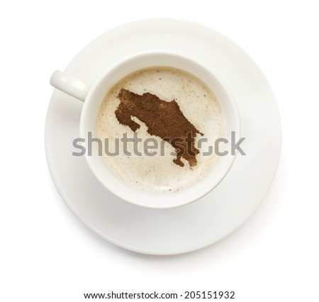 A cup of coffee with foam and powder in the shape of Costa Rica.(series) - stock photo
