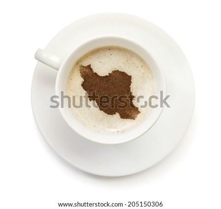A cup of coffee with foam and powder in the shape of Iran.(series) - stock photo