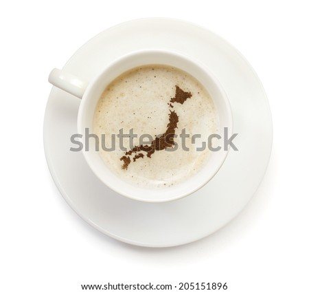 A cup of coffee with foam and powder in the shape of Japan.(series) - stock photo