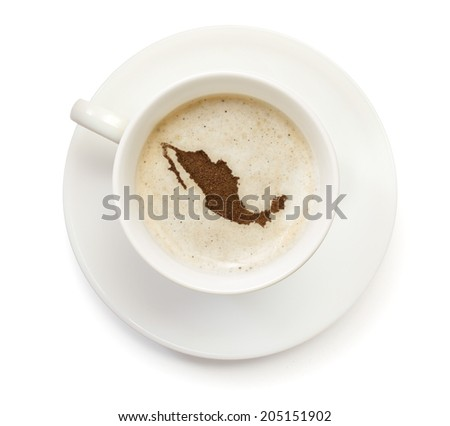 A cup of coffee with foam and powder in the shape of Mexico.(series) - stock photo