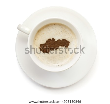 A cup of coffee with foam and powder in the shape of Slovakia.(series) - stock photo