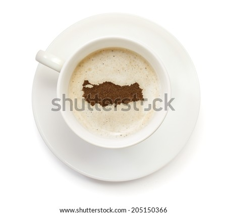 A cup of coffee with foam and powder in the shape of Turkey.(series) - stock photo