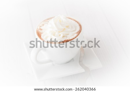 a cup of coffee with wheap cream with white background, vignetted - stock photo