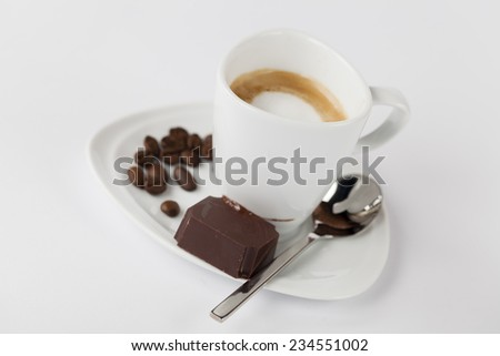 A cup of espresso isolated on a white background
