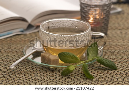 a cup of green tea with mint and cane sugar