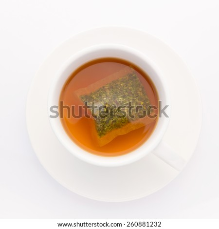 A cup of herb tea for detox on white background - stock photo