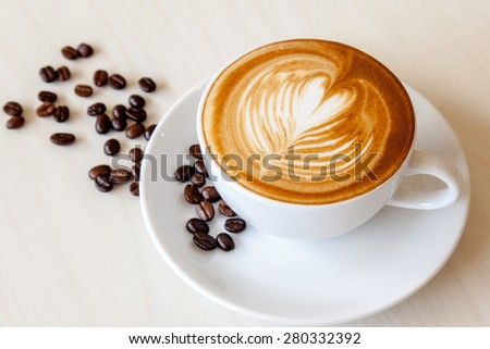 A cup of hot cafe' latte - stock photo
