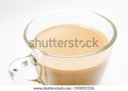 A cup of hot milk coffee isolated