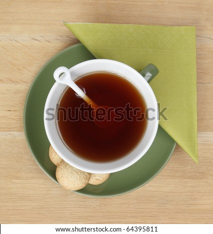 A cup of hot tea on a table - shot from above - stock photo