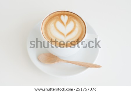 a cup of latte art on white background - stock photo