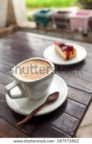 A Cup of latte coffee with cake - stock photo