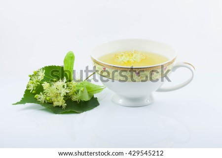 a Cup of Linden tea, Linden flower, white background - stock photo