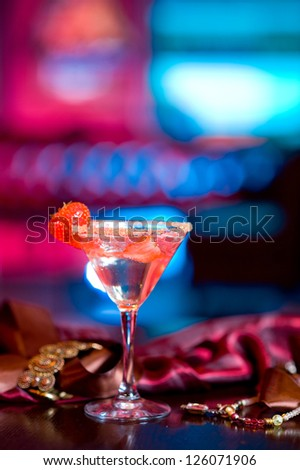 a cup of martini with strawberry - stock photo