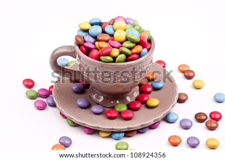 a cup of sugar coated chocolate pills - stock photo