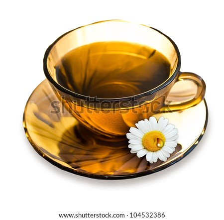 A cup of tea with a camomile and drop on a saucer isolated on white