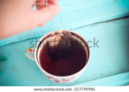 A cup of tea with tea bag  - stock photo