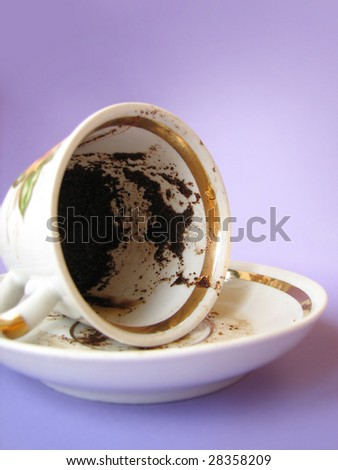 A cup of Turkish coffee, traditionally using for fortune telling - stock photo