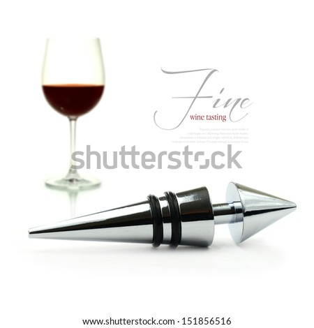 A curated image from my FINE series set. Stainless steel wine stopper with glass of burgundy wine in the background. The perfect image for a wine list design. Copy space. - stock photo