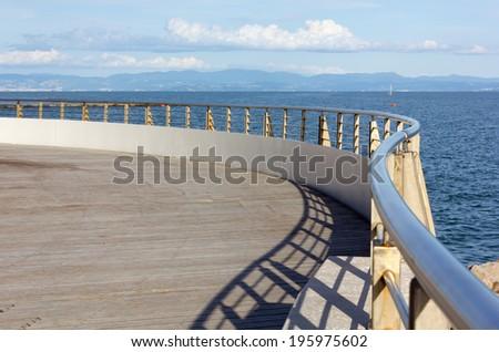 A Curve Shaped Terrace on the Sea - stock photo