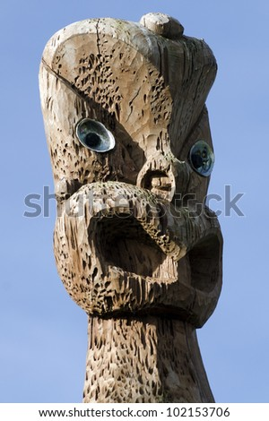 A curved Maori  statue in Auckland, New Zealand. - stock photo