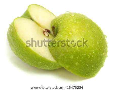 A cut apart fresh green apple with water drops and isolated on white background - stock photo