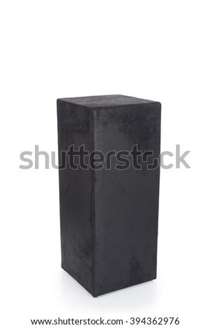 A cut-out of a short black rectangular block pedestal. - stock photo