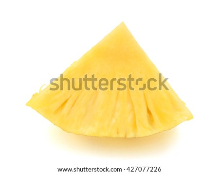 A cut slice of pineapple fruit isolated on white background - stock photo