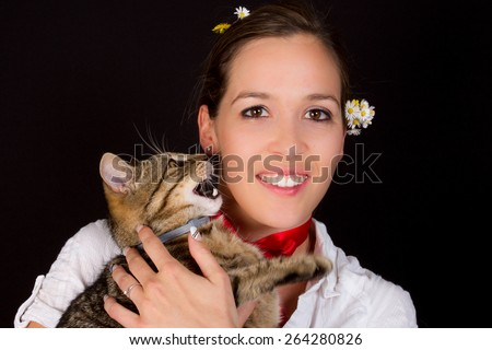 A cute and a young woman with european cat - stock photo