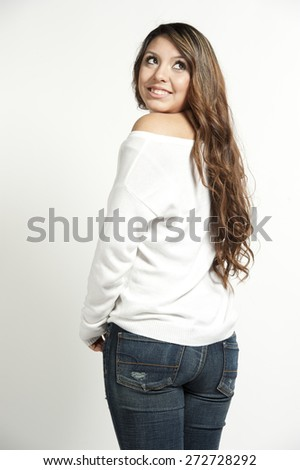 A cute and happy young girl posing on a white background in a studio on a white background. - stock photo