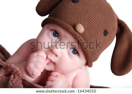 A cute baby boy sucking his thumb - stock photo