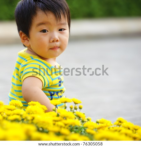 a cute baby is playing in garden - stock photo