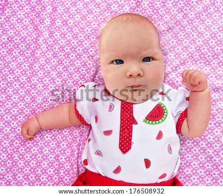 a cute baby on a blanket - stock photo