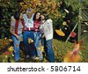 "a cute family is joking in the park. keyword for this collection is ""autumn77"" - stock photo"