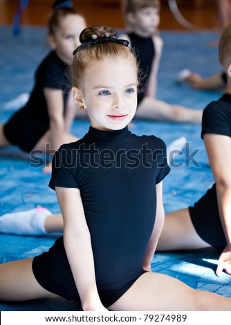 A cute girl is training in the gym - stock photo