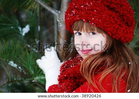 A cute girl playing in the snow - stock photo