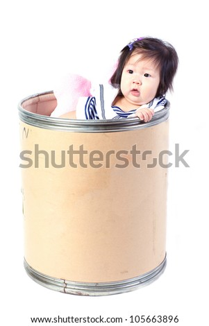 A cute girl sitting in a Chemical bucket on white background.