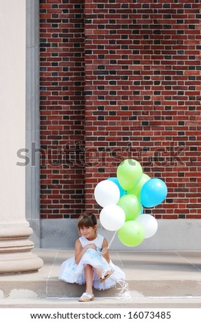 A cute girl sitting on the steps with her balloons - stock photo