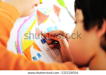 A cute little boy is drawing and being creative - stock photo