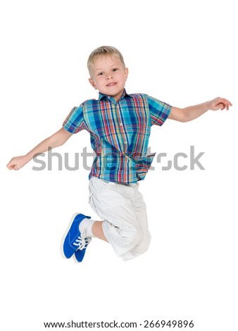 A cute little boy jumps on the white background - stock photo