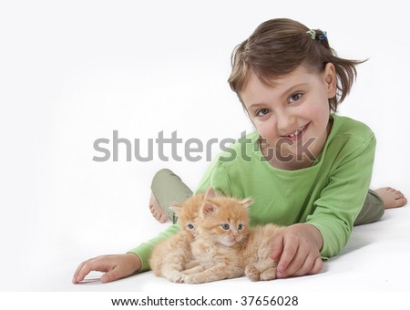 A cute little girl playing with baby cat